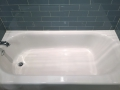 New Tub with Blue Glass Wall Tile